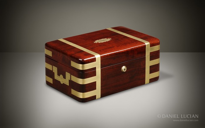 Antique Box in Mahogany with Brass Strapped Binding.