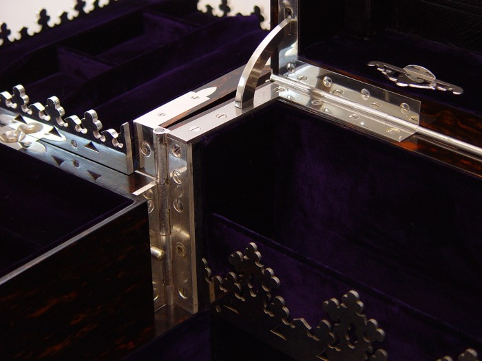 Silver plated hinge and gallery from a Jenner & Knewstub Antique Jewellery Box with Betjemann Patent Mechanism.