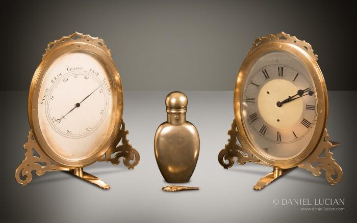 Strut Barometer, Silver-Gilt Perfume Bottle, and Strut Clock taken from an Asprey Antique Jewellery Box in Coromandel with Betjemann Patent Mechanism & Candlesticks.