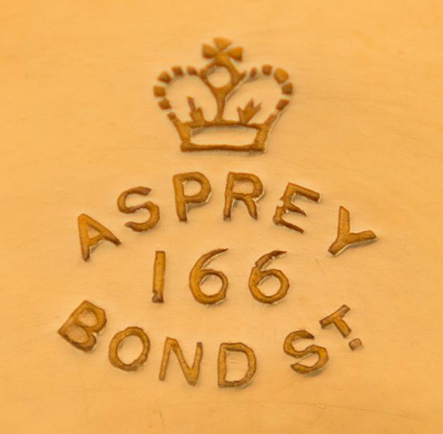 Asprey - 166 Bond Street Stamp onto a Silver-Gilt Dressing Case Fitting.