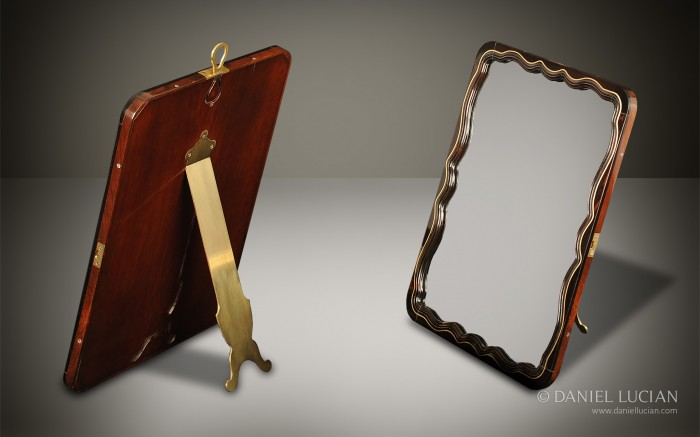 French Ebony Fronted Serpentine Mirror with Mahogany Back and Brass Hinged Stand.