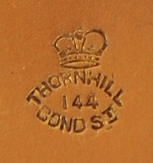 Thornhill Maker/ Retailer Stamp on the underside of a Silver-Gilt Vanity Jar Lid.